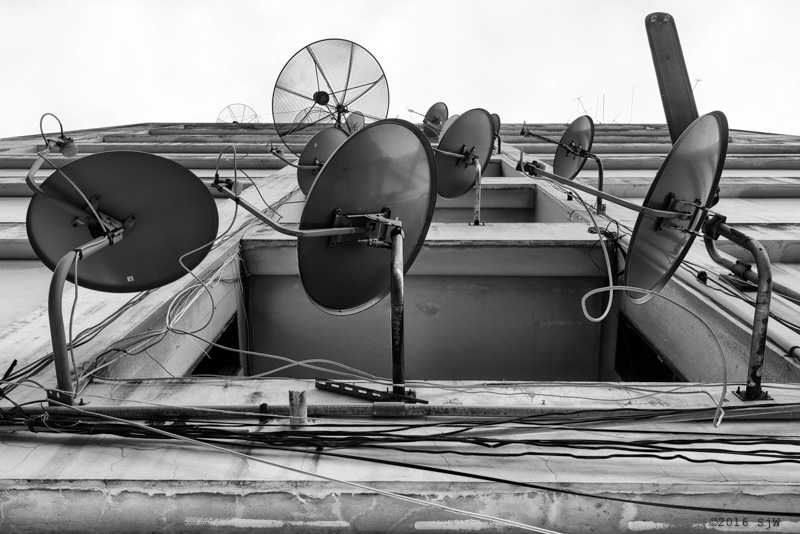 Satellite dishes on a wall in Bangkok