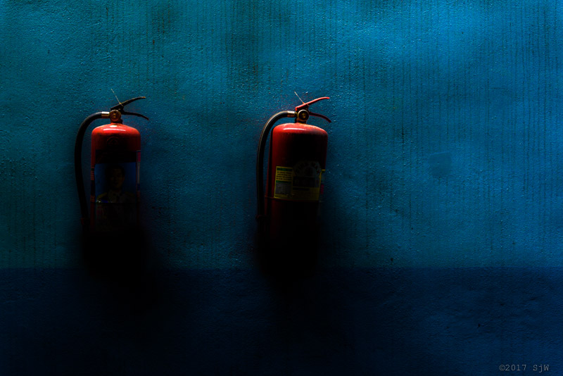 Fire extinguishers on a wall in Bangkok