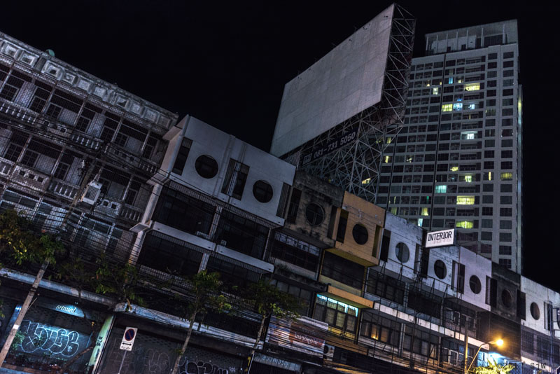 Buildings and billboard in Lat Phrao Rd. at night