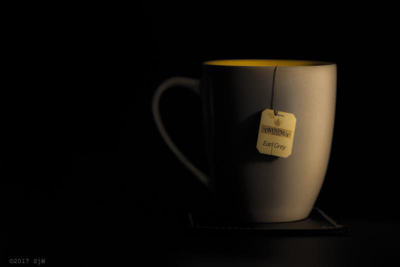 Mug of Earl Grey tea in shadow